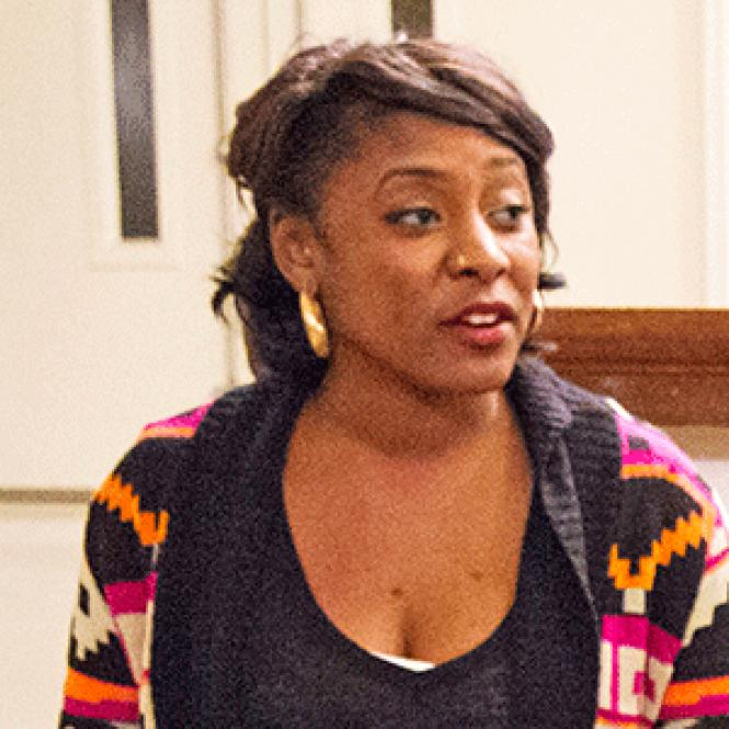 Alicia Garza listens to speakers at a Black Lives Matter<br>panel discussion in January. Photo: Alana Perino
