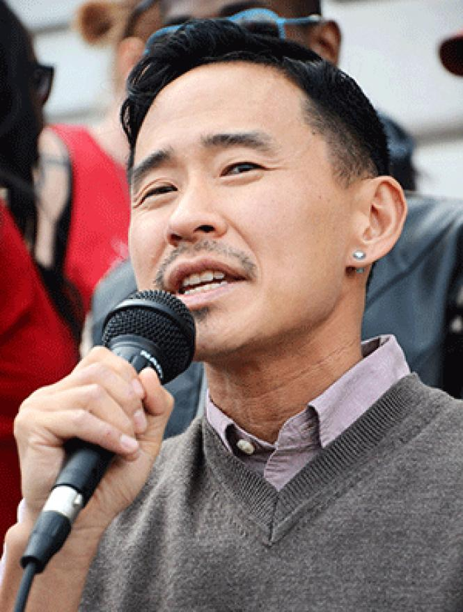 Transgender Law Center Executive Director Kris Hayashi<br>spoke at a rally decrying anti-trans violence in February outside San Francisco<br>City Hall. Photo: Rick Gerharter