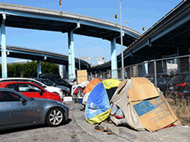 Homeless tent encampments are under the freeways at Division and 9th streets, South of Market. Photo: Rick Gerharter