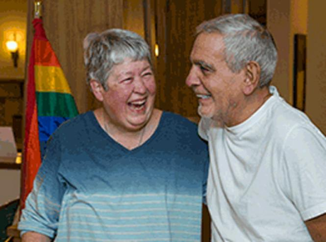 Fountaingrove Lodge residents Sharon Long, left, and Martin Devin celebrated returning to the lodge November 13 after being evacuated for more than a month.