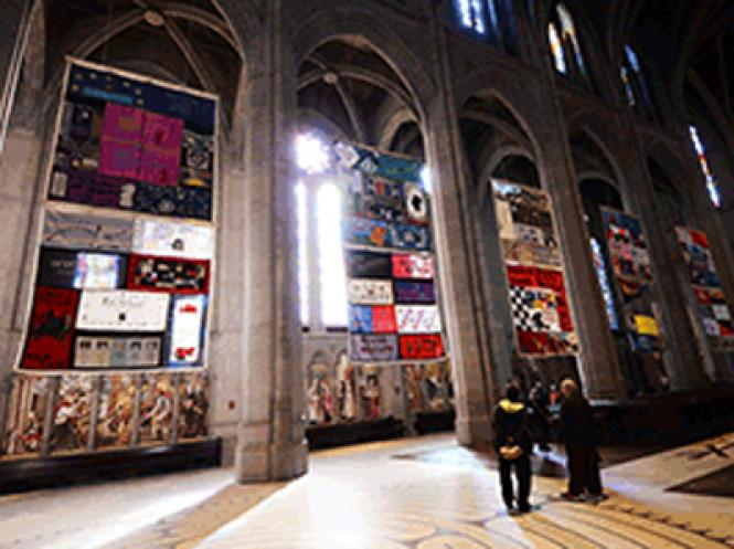 Panels of the AIDS Memorial Quilt from the Names Project hang in the main nave of Grace Cathedral on San Francisco's Nob Hill.