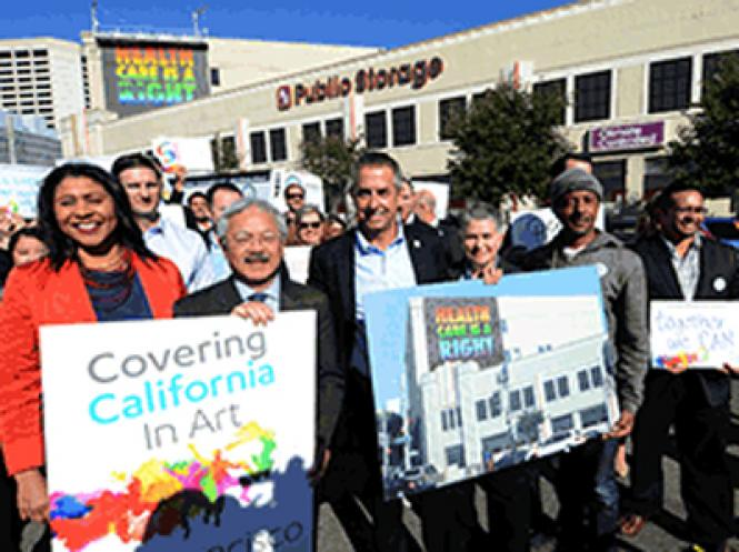 San Francisco Board of Supervisors President London Breed, Mayor Ed Lee, Peter V. Lee, Executive Director of Covered California, Dr. Vitka Eisen, CEO of HeathRight 360, the muralist APEXER and others celebrate the installation of a mural, background, that serves as a reminder that the enrollment period for Covered California ends December 15.