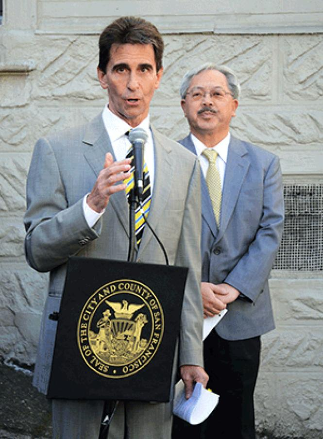 Then-state Senator Mark Leno talks about legislation in 2014 as Mayor Ed Lee stands behind him