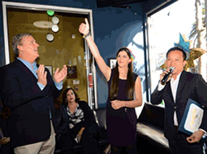 Virginia Delegate-elect Danica Roem (D), gave a thumbs up during a reception Sunday, December 10 at Beaux in the Castro as she was greeted by San Francisco Supervisor Jeff Sheehy, left, and Assemblyman David Chiu (D-San Francisco).