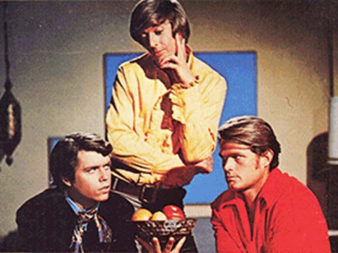 Michael Greer (standing) with Kevin Coughlin and Larry Casey in a lobby card poster for the 1969 film 'The Gay Deceivers'