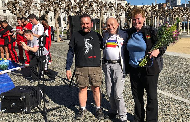 Previous Tom Waddell Award winners Gene Dermody, left, Brent Nichelson Earle, and Sara Waddell Lewinstein, attended the International Rainbow Memorial Run in San Francisco, which ended at United Nations Plaza. Photo: Eduardo Guardarramas