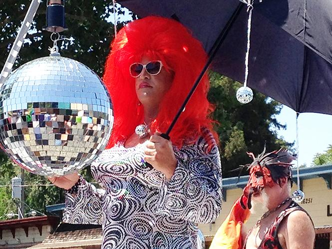 A performer holds a glitter ball at last year's Sonoma County Pride. Photo: Courtesy Sonoma County Pride