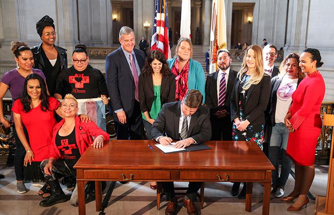 San Francisco interim Mayor Mark Farrell signs Supervisor Hillary Ronen's legislation Wednesday mandating gender-neutral bathrooms in single-room occupancy hotels