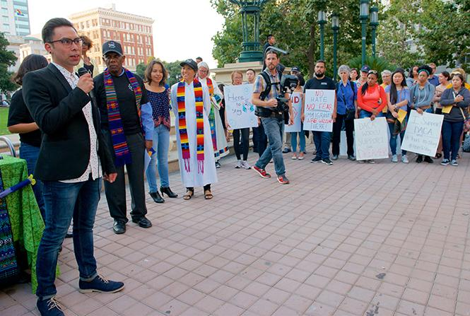 Gerardo Gomez, left, a gay man and DACA Dream fellow, addressed a crowd in Oakland last September in preparation for President Donald Trump's expected action on the Deferred Action for Childhood Arrivals program. Photo: Jane Philomen Cleland
