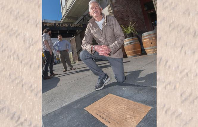 Sean Martinfield, who once served as master of ceremonies at Finocchio's, looks at the historical plaque unveiled February 16 outside the former female impersonators cabaret in North Beach. Photo: Jane Philomen Cleland