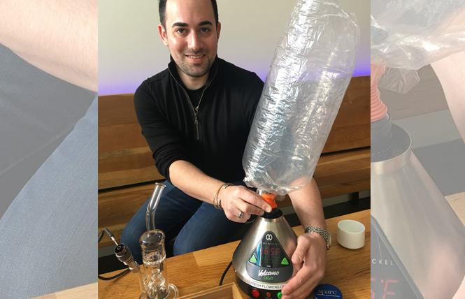 SPARC retail director Robbie Rainin shows off a Volcano vaporizer. Photo: Sari Staver