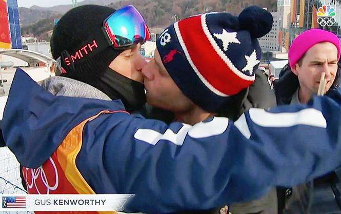 Gus Kenworthy kisses his boyfriend, Matthew Wilkas, during the Winter Olympics. Photo: NBC screenshot
