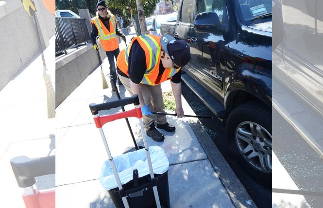 Glenn Santarosa, front, and Johnny Friedman from San Francisco Public Works, sweep up broken glass from a car window on Church Street near Market Sunday, February 25