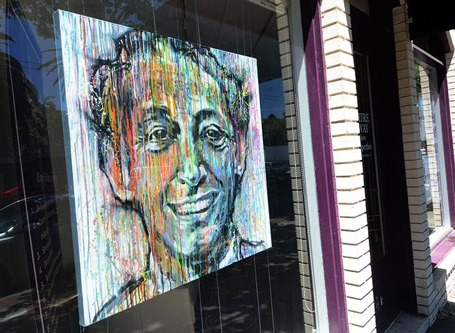As part of last year's Windows for Harvey project, the Berkshire Hathaway Realty office had a painting of Harvey Milk by Jun Yang in its Market Street office window. Photo: Rick Gerharter