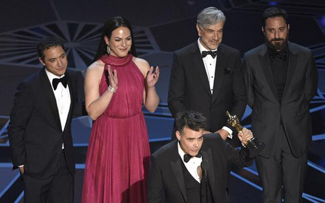 "Daniela Vega, second from left, stands on stage at the Oscars after ""A Fantastic Woman,"" which she starred in, won the best foreign language film award. Photo: Courtesy AP"