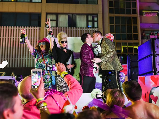 "Stuart Henshall, third from left, kisses his new husband, James Brechney, on their float March 3 in the Sydney Gay and Lesbian Mardi Gras parade as onlookers and lookalikes from ""Absolutely Fabulous"" cheer. Photo: Phat Ngo Photography"