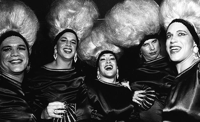 Members of the Muscle System gym, done up in drag for their annual Halloween drag party, celebrate at Cafe San Marcos in 1990
