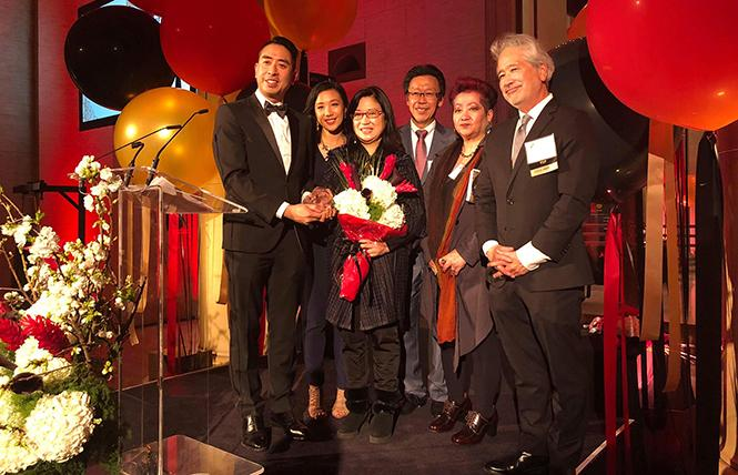 AABA President David Tsai, left, presents the Trailblazer Award (posthumously) to Anita Lee, widow of San Francisco mayor Ed Lee. Behind them are, from left, Catherine Ngo, Judge Edward Chen, Esther Leong, and Don Tamaki. Photo: Francis Tsang