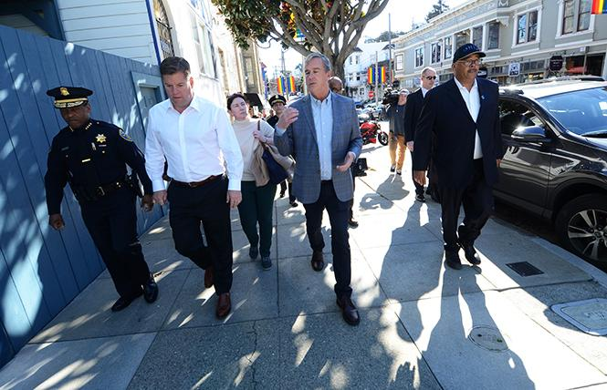 City officials including, from left, Police Chief William Scott, Mayor Mark Farrell, Supervisor Jeff Sheehy, and Public Works Director Mohammed Nuru, walked through the Castro district Monday to see the public safety issues in the neighborhood.