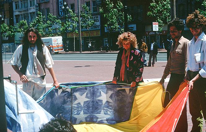 Gilbert Baker, left, and Lynn Segerblom hold one of the first two rainbow flags that were flown at the 1978 San Francisco Pride parade and celebration. Photo: James McNamara, courtesy Paul Langlotz Lynn Segerblom, left, with Gilbert Baker at the 1978 San Francisco Pride celebration.