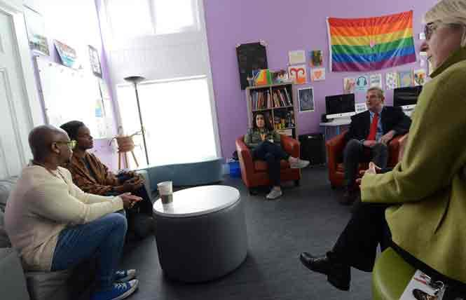Supervisor Jeff Sheehy, right, paid a visit and heard from staff members of San Francisco's LGBT Community Center's LGBT youth drop-in program. From left are Zami Tinashe Hyemingway, Levi Maxwell, Vanessa Teran, and Rebecca Rolfe, executive director of the center, on the extreme right. Photo: Rick Gerharter