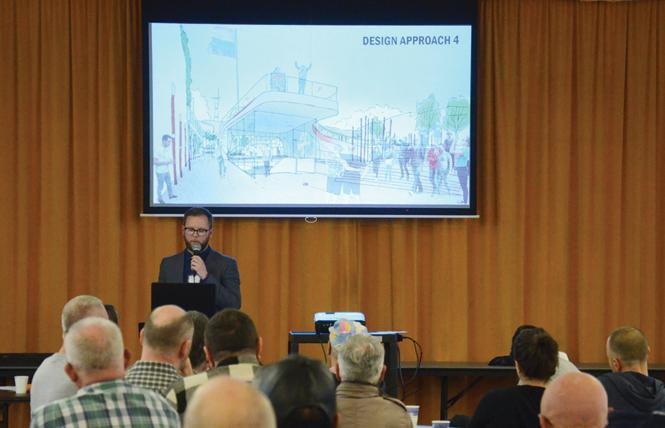 Justin Skoda from Perkins Eastman architects describes one of the four design proposals for Harvey Milk Plaza before a crowd of Castro area neighbors April 7. Photo: Rick Gerharter.