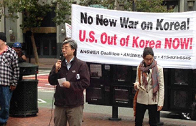 Paul Liem of Hella Organized Bay Area Koreans calls for a freeze in tensions with North Korea at an August 15 protest. Photo: Christina A. DiEdoardo
