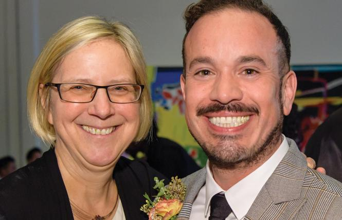 Rebecca Rolfe and Roberto Ordeñana greeted attendees at the LGBT center's Soiree benefit April 14. Photo: Trish Tunney
