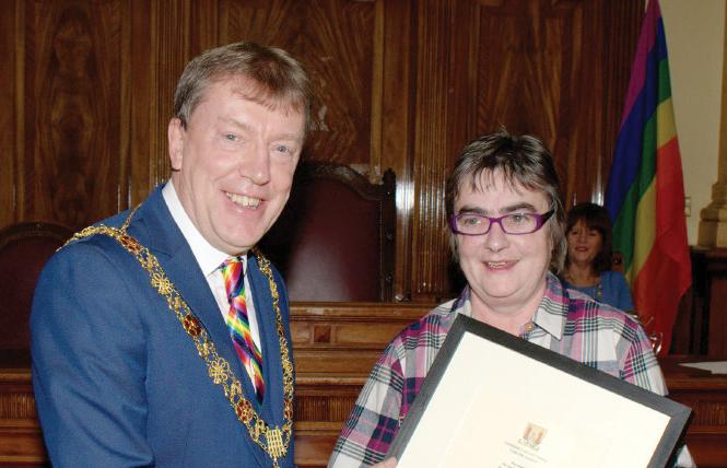Lord Mayor of Cork Tony Fitzgerald, left, joined Siobhán O'Dowd, chair Cork City LGBT Inter-Agency Group, at a presentation to mark the city agency winning the national award in Ireland for LGBT Ally. Courtesy: Siobhán O'Dowd