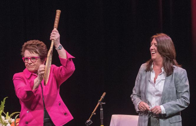 Tennis legend Billie Jean King, left, played air guitar on a tennis racket that Kate Kendell auctioned off as a fundraiser for the National Center for Lesbian Rights. Photo: Jane Philomen Cleland