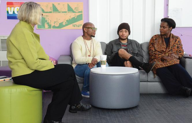 Angel, center on couch, is a client of the LGBT Community Center's Youth Drop-In center, whose staff includes Rebecca Rolfe, left, executive director; Zami Tinashe Hyemingway; and Levi Maxwell. Photo: Rick Gerharter