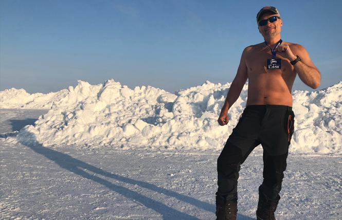 Larry Rich stands with his medal after the North Pole Marathon. Photo: Courtesy Larry Rich