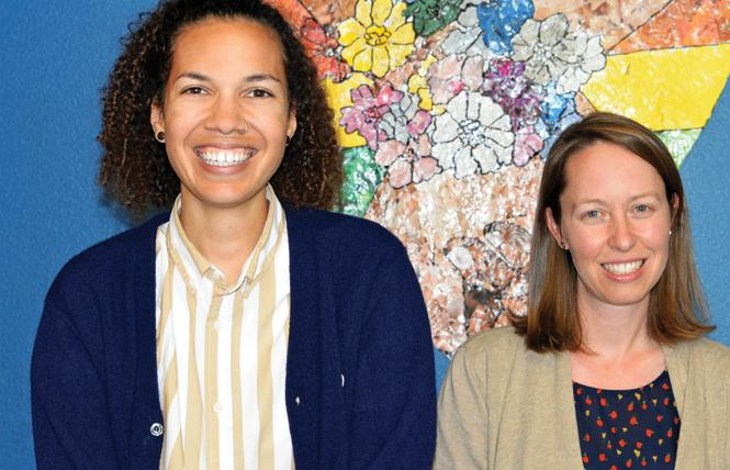 "Adrienne Keel, left, the new head of the LGBTQ Youth Space, stands with former director Cassandra ""Cassie"" Blume. Photo: Jo-Lynn Otto"