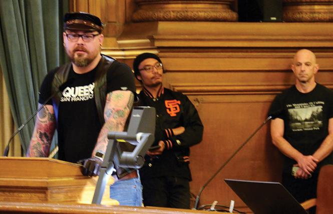 People, including Geoff Millard, at podium, line up to speak to the Land Use Committee of the San Francisco Board of Supervisors in support of creating an LGBTQ and Leather Cultural District in the South of Market area. Photo: Rick Gerharter