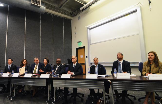 The candidates for San Francisco Superior Court judge, from left: Judge Andrew Cheng, Maria Evangelista, Judge Curtis Karnow, Judge Cynthia Lee, Kwixuan Maloof, Judge Jeff Ross, Niki Solis, Phoenix Street, and Elizabeth Zareh talked at a recent forum held at Golden Gate University. Photo: Rick Gerharter