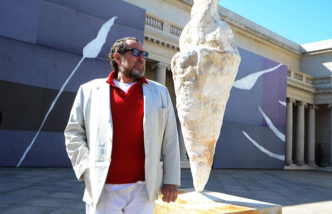 "Julian Schnabel stands amidst his paintings and sculptures exhibited in the Court of Honor at the Palace of the Legion of Honor, site of an exhibition of his work, ""Symbols of Actual Life."" Photo: Rick Gerharter"