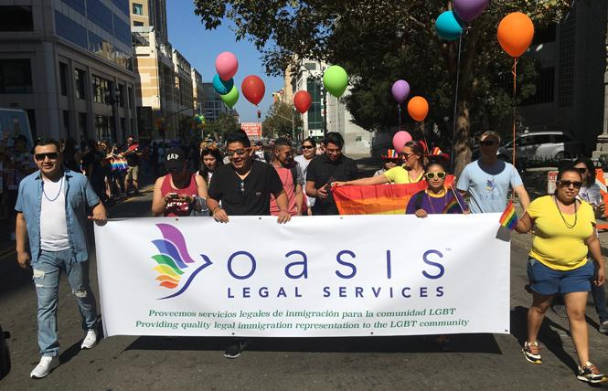 Supporters of Oasis Legal Services at Oakland Pride. Photo: Courtesy Oasis Legal Services