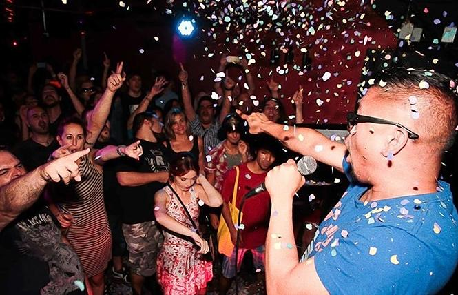 """Bitter Melon"" director H.P. Mendoza cheers on the crowd. Photo: Courtesy CAAMfest"