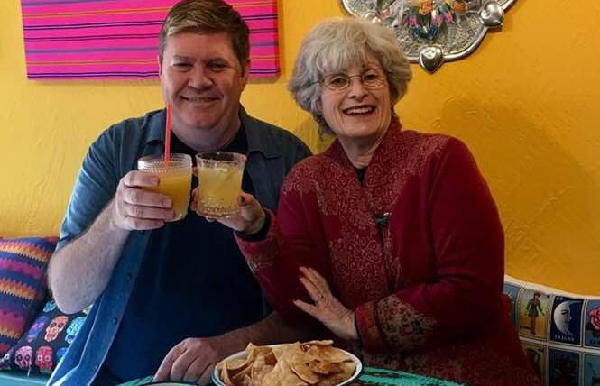 Rick Hamer, left, and Joan Simon celebrate the opening of Hamer's Papi Rico with a toast. Photo: Sari Staver
