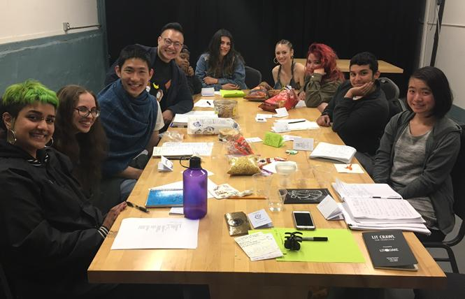 "Meliza Banales with Queer Ancestors Project students work on ""Tender: Queer Ancestors Project Anthology,"" which will be unveiled Saturday. Photo: Courtesy Celeste Chan"