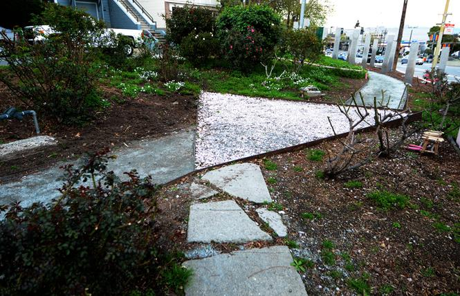 The walkway and rose quartz triangle are shown at the Pink Triangle Park and Memorial Rose Garden. Photo: Rick Gerharter