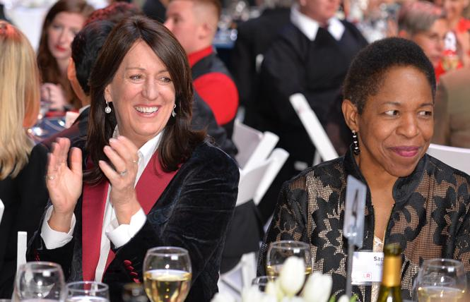 Kate Kendell, left, outgoing executive director of the National Center for Lesbian Rights, shared a moment with her wife, Sandy Holmes, at the agency's 41st annual gala May 19 at the Palace of Fine Arts in San Francisco. Photo: Jo-Lynn Otto