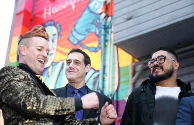 Patrik Gallineaux, left, national LGBT ambassador for Stoli USA, joined Stuart Milk and muralist Oz Montania in front of the new mural commemorating Harvey Milk outside the Cafe bar May 22. Photo: Kelly Sullivan