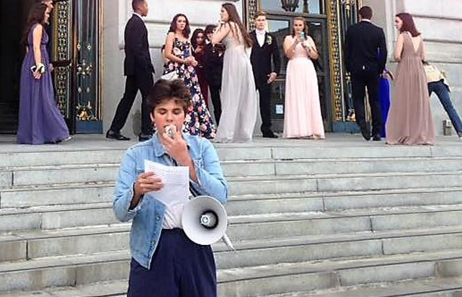 High school student Jake Cohen addresses a crowd of about 80 people protesting gun violence at City Hall while prom attendees file in behind him. Photo: Christina A. DiEdoardo