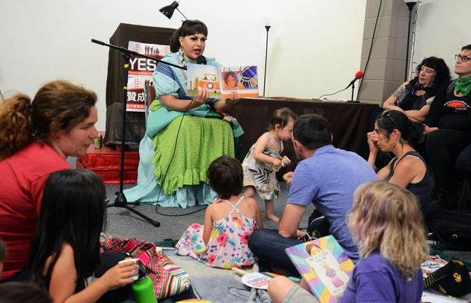 "Drag queen Landa Lakes, who identifies as two spirit, reads ""47,000 Beads"" to children at the first Two-Spirit Storytime. Photo: Rick Gerharter"