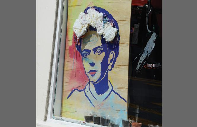 A painting of Frida Kahlo sits in the window of Pixie Hall Studios in Noe Valley. Photo: Rick Gerharter