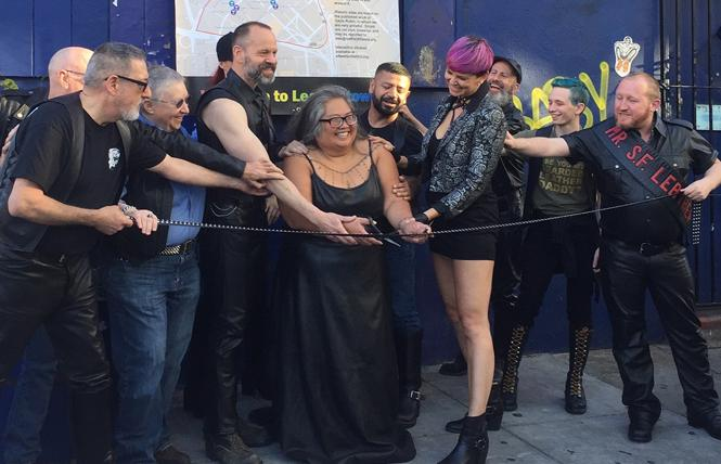 Rachele Sullivan, center, cuts a ribbon outside the Stud bar Tuesday to celebrate the designation of San Francisco's Leather and LGBTQ Cultural District. Photo: Liz Highleyman