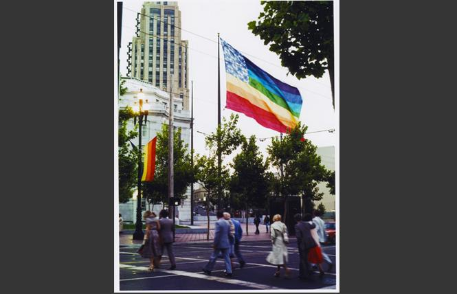 The first rainbow flags fly on Market Street the day of the 1978 San Francisco Pride parade. Photo: Mark Rennie