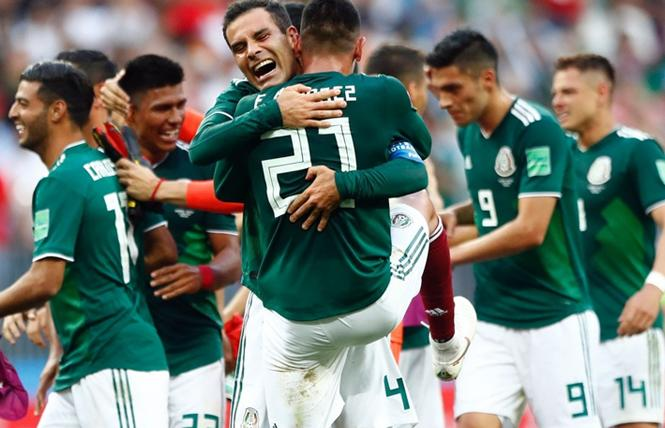 Mexico players celebrate their stunning 1-0 victory over defending World Cup champion Germany Sunday in Moscow. Photo: Courtesy AP