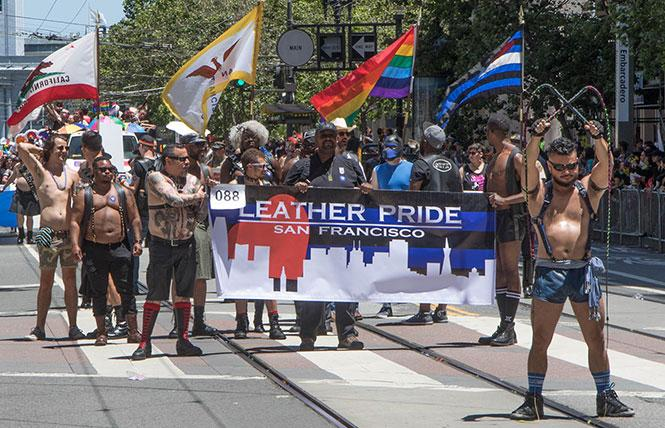 The Leather Pride contingent marched in the 2018 LGBT Pride March on Sunday, June 24. Whip master Danny Thanh Nguyen's skills got a lot of applause.